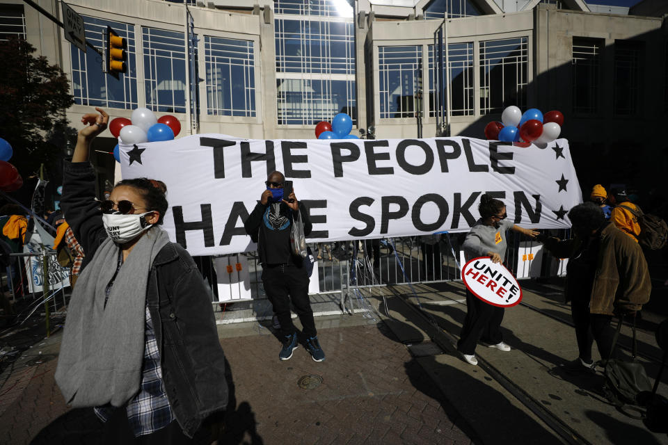 Demonstrators rally outside the Pennsylvania Convention Center where votes are being counted, Friday, Nov. 6, 2020, in Philadelphia. (AP Photo/Rebecca Blackwell)