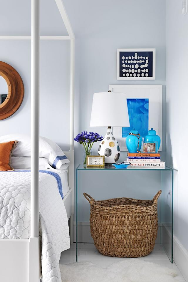 """<p>Place a basket underneath an open bedside table to create an undercover drop for dirty laundry or throw pillows. </p><p><a class=""""body-btn-link"""" href=""""https://www.amazon.com/Household-Essentials-ML-4002-Hyacinth-Handles/dp/B00Q7XUUC2/?tag=syn-yahoo-20&ascsubtag=%5Bartid%7C10055.g.2818%5Bsrc%7Cyahoo-us"""" target=""""_blank"""">SHOP BASKETS </a><strong><br></strong></p><p><strong>RELATED: </strong><a href=""""https://www.goodhousekeeping.com/home/decorating-ideas/g770/decor-ideas-master-bedroom/"""" target=""""_blank"""">Decor Ideas to Transform Your Master Bedroom </a></p>"""