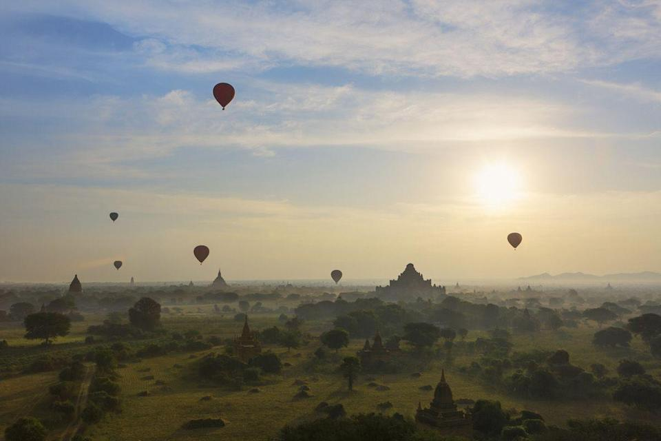 <p>Hot air balloons at sunrise in Bagan, Myanmar // January 29, 2014</p>