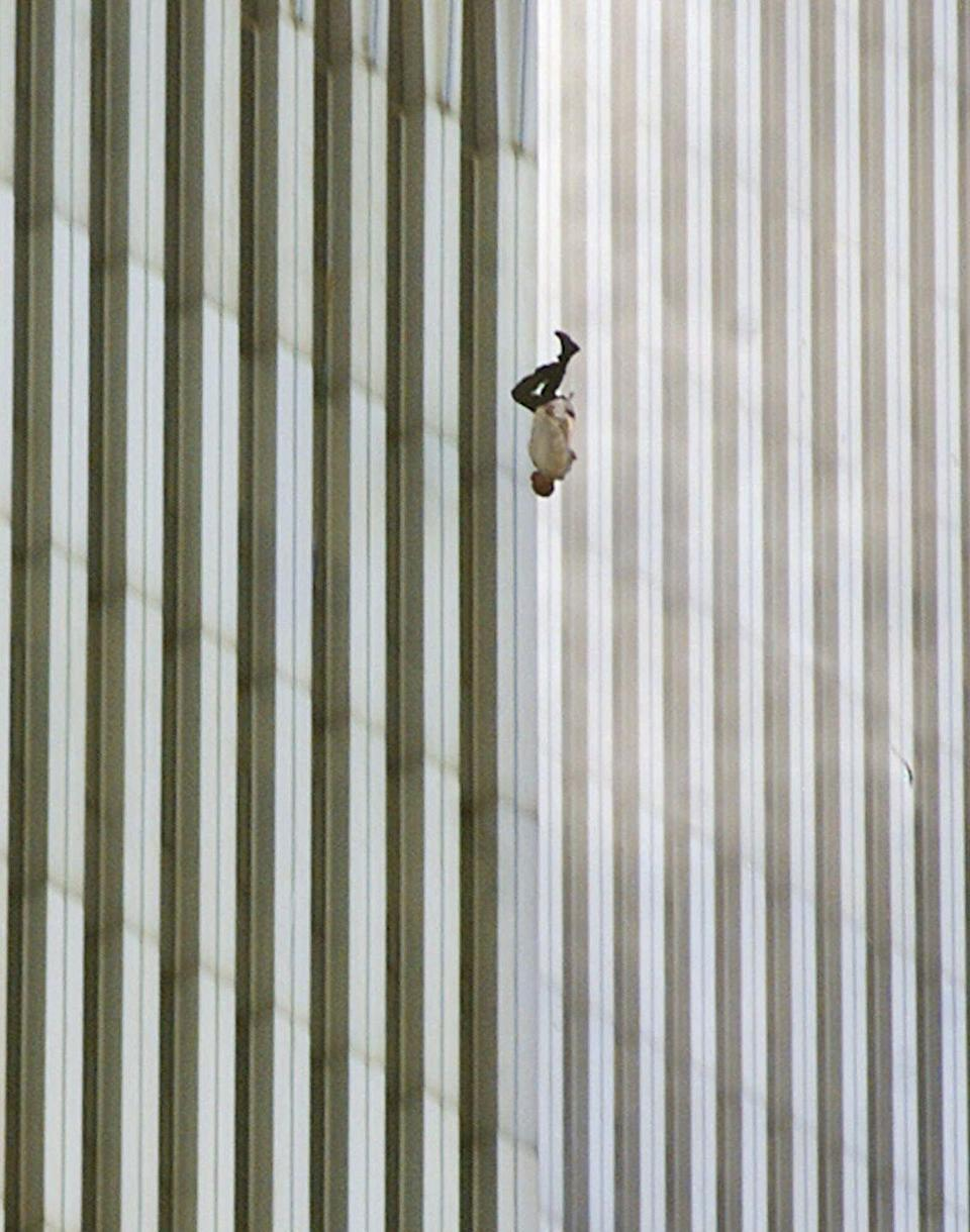 <p>2001. AP Caption: A person falls headfirst from the north tower of New York's World Trade Center Tuesday, Sept. 11, 2001.</p>