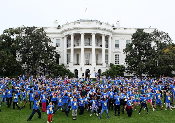 U.S. first lady Michelle Obama greets children at an event on the South Lawn of the White House in Washington October 11, 2011 to launch a challenge to help break the Guinness World Records title for the most people doing jumping jacks in a 24-hour period. To break the record, more than 20,000 people from around the world must perform jumping jacks for one minute.