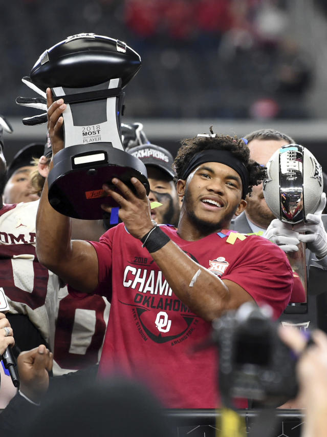 FILE - In this Dec. 1, 2018, file photo, Oklahoma quarterback Kyler Murray hoists the Most Outstanding Player trophy after beating Texas 39-27 in the Big 12 Conference championship NCAA college football game, in Arlington, Texas. Murray was named The Associated Press college football Player of the Year, Thursday, Dec. 6, 2018. (AP Photo/Jeffrey McWhorter, File)