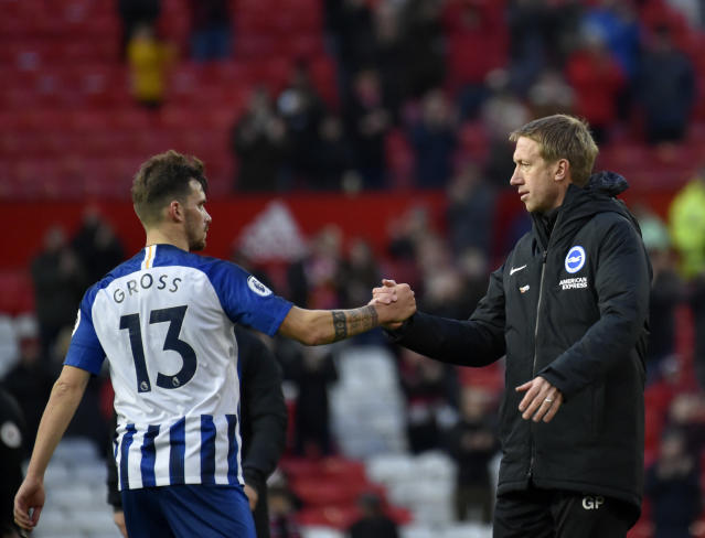 Brighton's head coach Graham Potter, right, shakes hands with Brighton's Pascal Gross at the end of the English Premier League soccer match between Manchester United and Brighton and Hove Albion, at the Old Trafford stadium in Manchester, England, Sunday, Nov. 10, 2019. (AP Photo/Rui Vieira)