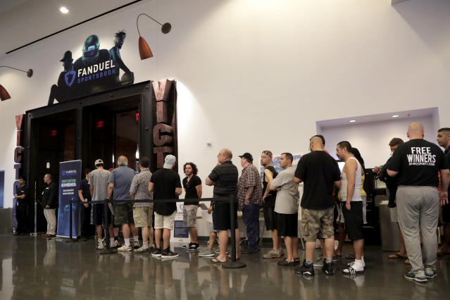 People wait in line to enter the FanDuel Sportsbook at the Meadowlands Racetrack in East Rutherford, N.J., on July 14, 2018. (AP Photo/Julio Cortez)