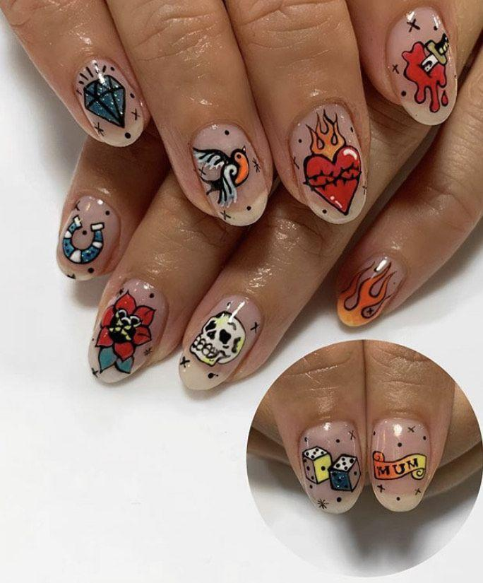 """<p>Think outside the traditional Halloween, err, coffin, with this old school <a href=""""https://www.instagram.com/p/B4f5W_VASiw/"""" rel=""""nofollow noopener"""" target=""""_blank"""" data-ylk=""""slk:tattoo-themed nail art by Emily Isabella"""" class=""""link rapid-noclick-resp"""">tattoo-themed nail art by Emily Isabella</a> that could work with a variety of costumes—or just on their own!</p><p><a class=""""link rapid-noclick-resp"""" href=""""https://go.redirectingat.com?id=74968X1596630&url=https%3A%2F%2Fwww.urbanoutfitters.com%2Fshop%2Ftattoo-art-nails-kit&sref=https%3A%2F%2Fwww.oprahmag.com%2Fbeauty%2Fskin-makeup%2Fg33239588%2Fhalloween-nail-ideas%2F"""" rel=""""nofollow noopener"""" target=""""_blank"""" data-ylk=""""slk:SHOP NAIL KIT"""">SHOP NAIL KIT</a></p>"""