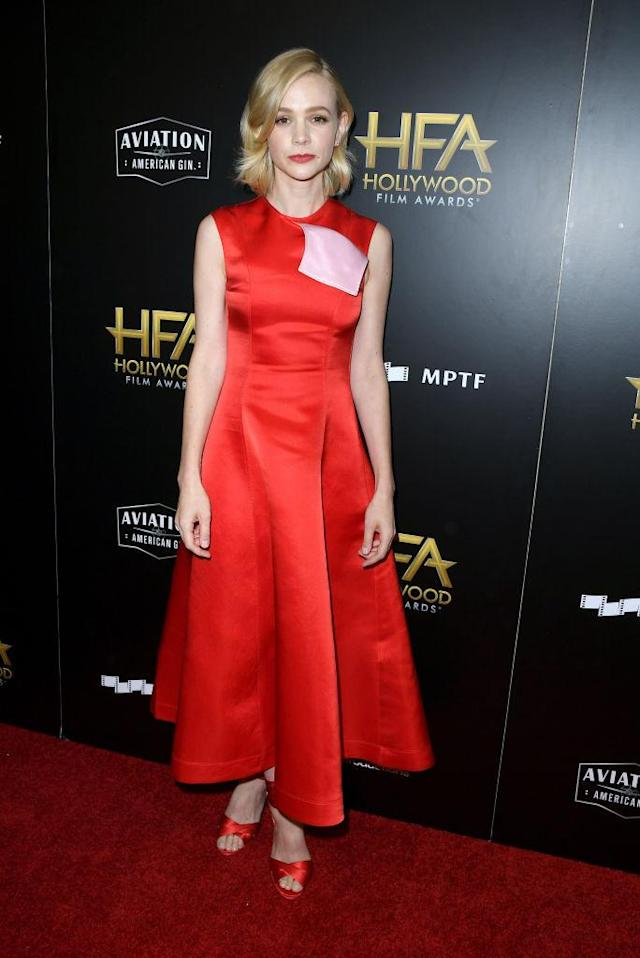 <p>Mulligan looked beautifully classic in an all red and satin Calvin Klein look. (Photo: Getty Images) </p>