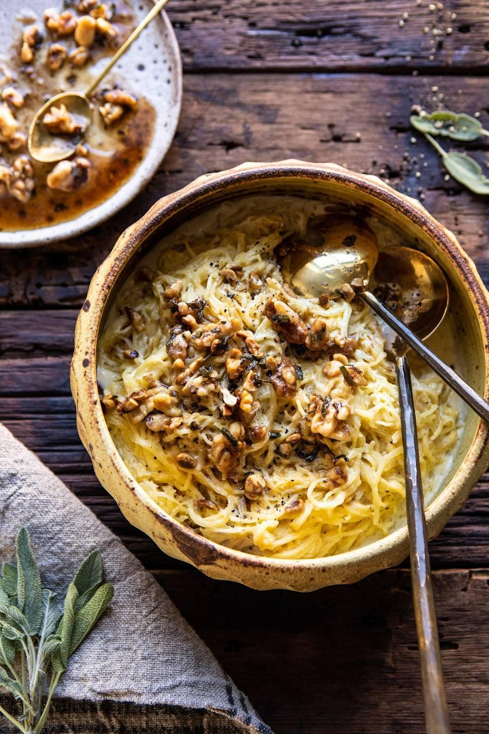 """<p>This spaghetti squash recipe is unlike any other, and that's due to the creamy goat cheese-based cream sauce that it's made with. With the rich flavors of pesto and a dash of garlic, this hearty spaghetti squash will fill you up. Feel free to add mushrooms, basil, or even a hint of rosemary if you want to shake things up. Cut this recipe in half, and you'll have enough for two, plus some leftovers.</p> <p><strong>Get the recipe:</strong> <a href=""""https://www.halfbakedharvest.com/creamed-spaghetti-squash/"""" class=""""link rapid-noclick-resp"""" rel=""""nofollow noopener"""" target=""""_blank"""" data-ylk=""""slk:creamed spaghetti squash with browned butter walnuts"""">creamed spaghetti squash with browned butter walnuts</a></p>"""