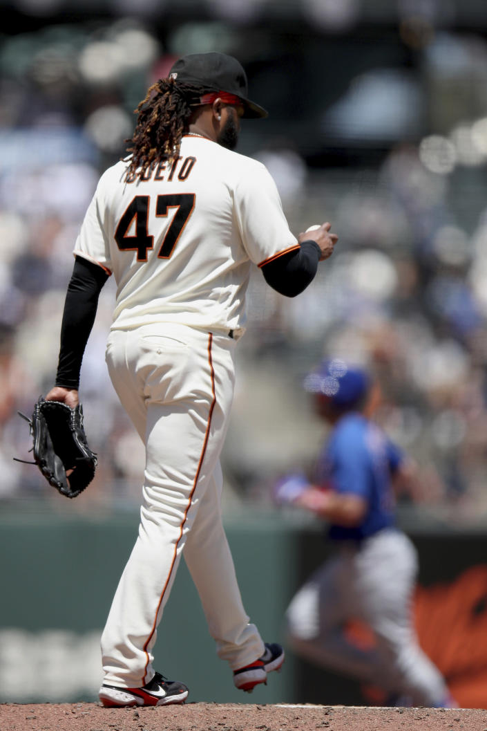 San Francisco Giants starting pitcher Johnny Cueto walks back to the mound as Chicago Cubs' Patrick Wisdom (16) rounds the bases after a home run in the fourth inning of a baseball game Sunday, June 6, 2021, in San Francisco. (AP Photo/Scot Tucker)