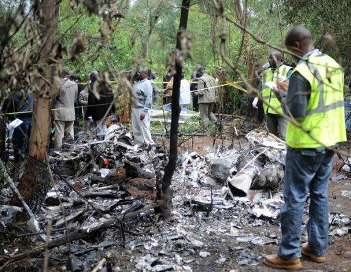 Kenyan forensic experts collect evidence at the site of the crash