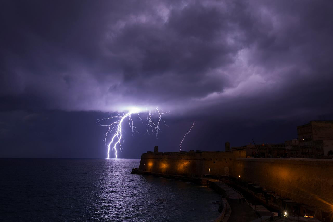 <p>A lightning bolt strikes the sea near Fort St Elmo during a storm in Valletta, Malta Feb. 27, 2019. (Photo from Darrin Zammit Lupi/Reuters) </p>