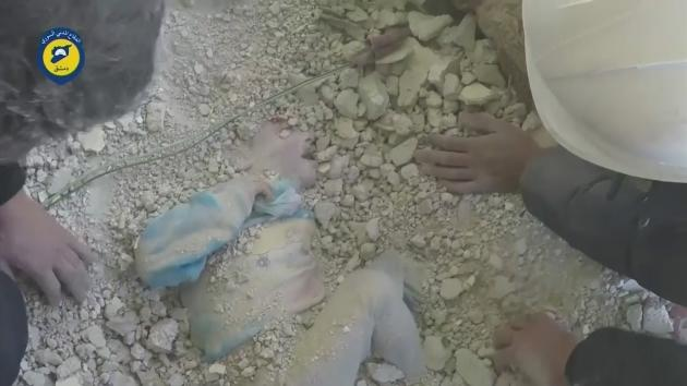 A young girl has been rescued alive from underneath the rubble of a building in Damascus after an airstrike. .