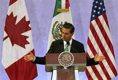 Mexico's President Pena Nieto gives a speech during a news conference at the North American Leaders' Summit in Toluca