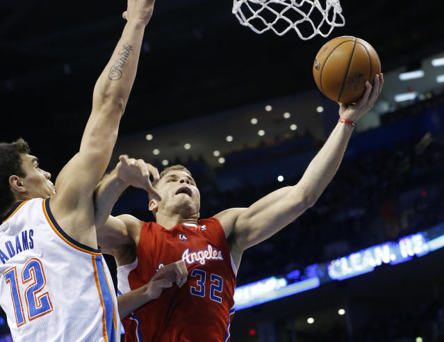 Los Angeles Clippers forward Blake Griffin (32) shoots in front of Oklahoma City Thunder center Steven Adams (12) in the first quarter of an NBA basketball game in Oklahoma City, Thursday, Nov. 21, 2013. (AP Photo/Sue Ogrocki)