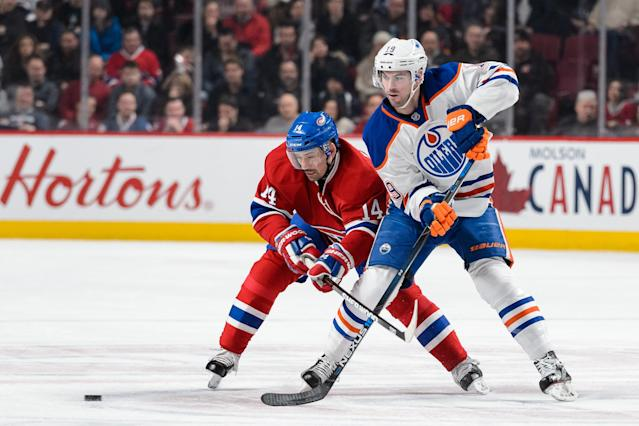 MONTREAL, QC - FEBRUARY 06: Tomas Plekanec #14 of the Montreal Canadiens and Justin Schultz #19 of the Edmonton Oilers skate after the puck during the NHL game at the Bell Centre on February 6, 2016 in Montreal, Quebec, Canada. (Photo by Minas Panagiotakis/Getty Images)