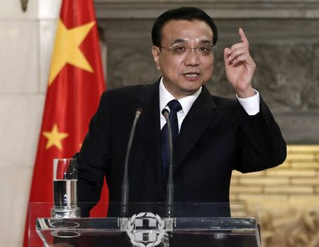 China's Premier Li addresses journalists during a joint news briefing in Athens