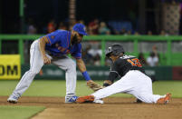 Miami Marlins' Starlin Castro (13) steals second base as New York Mets shortstop Amed Rosario attempts the tag during the third inning of a baseball game Friday, June 29, 2018, in Miami. (AP Photo/Wilfredo Lee)