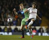 Newcastle United's Jack Colback, left, challenges Tottenham's Benjamin Stambouli for the ball during their English League Cup soccer quarterfinal match between Tottenham Hotspur and Newcastle United at White Hart Lane stadium in London, Wednesday, Dec. 17, 2014. (AP Photo/Alastair Grant)