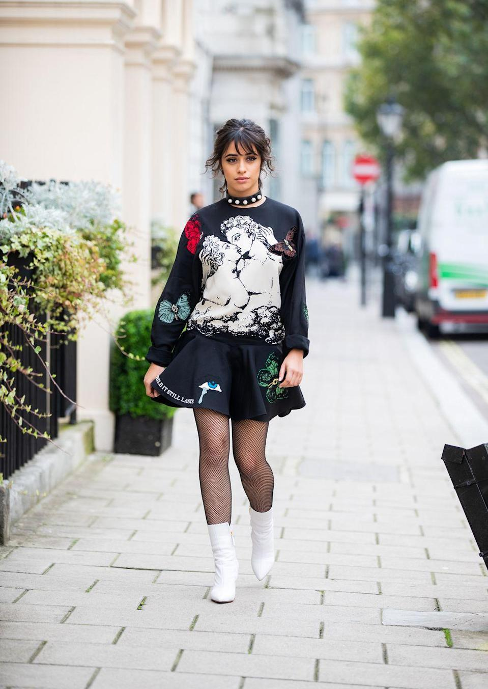 """<p>Filing this photo away under """"Proof That Sweats Are Perfect For Every Occasion."""" Pair a sweatshirt with a mini skirt and booties (plus, LOTS of pearls) for a Camila Cabello-approved pair-up.</p><p><strong>What you'll need:</strong> <em>Venus Crew Sweatshirt, $40, And I Get Dressed</em></p><p><a class=""""link rapid-noclick-resp"""" href=""""https://andigetdressed.com/merch/grey-ruffley-doop-crew/"""" rel=""""nofollow noopener"""" target=""""_blank"""" data-ylk=""""slk:SHOP NOW"""">SHOP NOW</a></p>"""