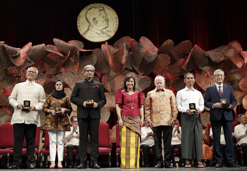 Philippine Vice President Leonor Robredo, center, and Ramon Magsaysay Chair, Board of Trustees, Jose Cuisia Jr., 3rd from right, pose with this year's Ramon Magsaysay awardees, from left, Filipino Raymundo Pujante Cayabyab, Thai Angkhana Neelapaijit, Indian Ravish Kumar, Burmese Ko Swe Win and South Korean Kim Jong-Ki during ceremonies in Manila, Philippines Monday, Sept. 9, 2019. Five people are being honored as this year's winners of the Ramon Magsaysay Awards, regarded as Asia's version of the Nobel Prize, including a South Korean who helped fight bullying and suicide and a Thai housewife who became a human rights defender after losing her husband to violence in southern Thailand. (AP Photo/Aaron Favila)