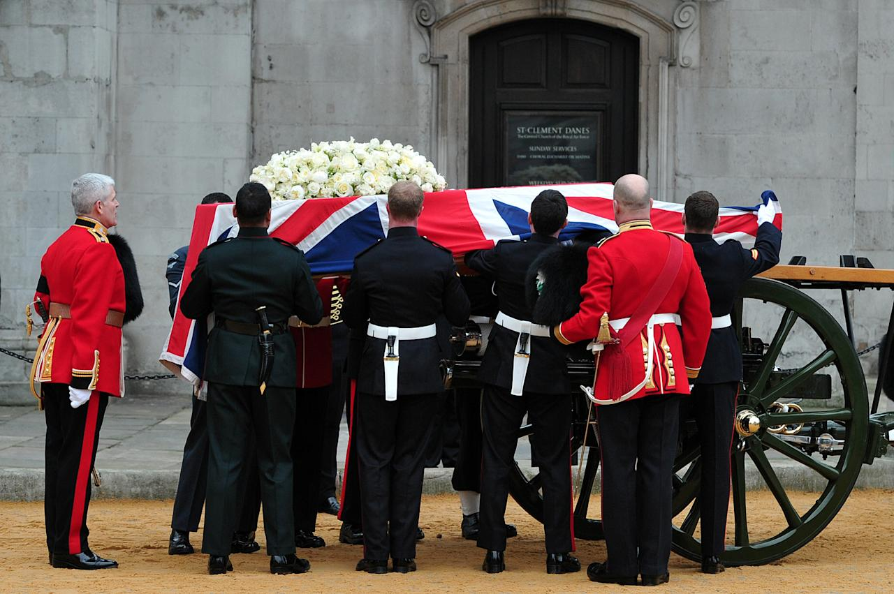 LONDON, ENGLAND - APRIL 17: The Bearer Party, made up of personnel from the three branches of the military, transfer the coffin of British former prime minister Margaret Thatcher onto a gun carriage to be drawn by the King's Troop Royal Horse Artillery during her ceremonial funeral at the Church of St Clement Danes  on April 17, 2013 in London, England. Dignitaries from around the world today join Queen Elizabeth II and Prince Philip, Duke of Edinburgh as the United Kingdom pays tribute to former Prime Minister Baroness Thatcher during a Ceremonial funeral with military honours at St Paul's Cathedral. Lady Thatcher, who died last week, was the first British female Prime Minister and served from 1979 to 1990  (Photo by Carl Court  - WPA Pool/Getty Images)