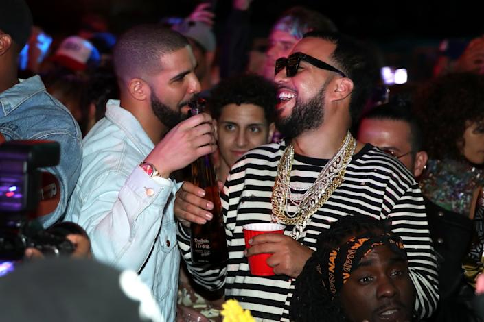 Drake and French Montana attend The Levi's Brand Presents NEON CARNIVAL with Tequila Don Julio.