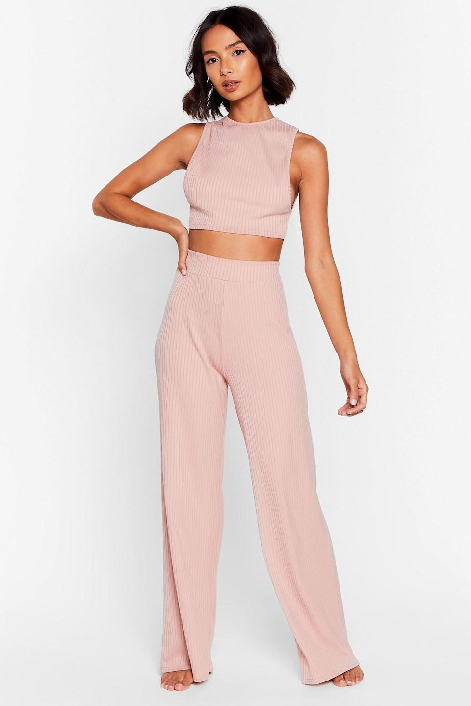 "<br><br><strong>NastyGal</strong> Side Show Crop Top and Wide-Leg Pants Lounge Set, $, available at <a href=""https://go.skimresources.com/?id=30283X879131&url=https%3A%2F%2Fwww.nastygal.com%2Fside-show-crop-top-and-wide-leg-pants-lounge-set%2FAGG51629.html%3Fcolor%3D107"" rel=""nofollow noopener"" target=""_blank"" data-ylk=""slk:NastyGal"" class=""link rapid-noclick-resp"">NastyGal</a>"