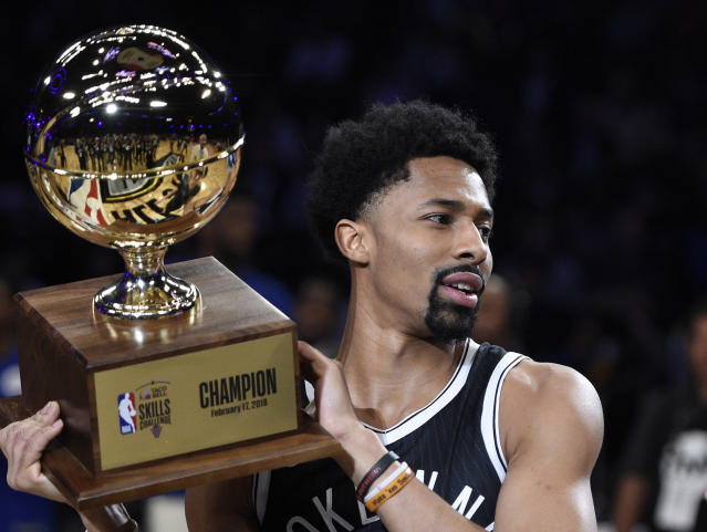 Brooklyn Nets guard Spencer Dinwiddie holds up his trophy after winning the 2018 Taco Bell Skills Challenge at All-Star Saturday Night in Los Angeles. (AP)