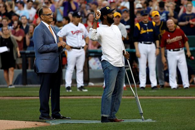 Special Agent David Bailey of the U.S. Capitol Police, with former Yankees manager Joe Torre, throws out the first pitch during the congressional baseball game at Nationals Park. (Photo: Aaron P. Bernstein/Reuters)