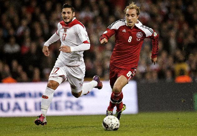 Malta's Ryan Fenech, left, and Denmark's Christian Eriksen, right, vie for the ball during their Group B 2014 FIFA World Cup qualifying soccer match played in Parken, Copenhagen on Tuesday, Oct 15, 2013. (AP Photo/Jens Dresling, POLFOTO)