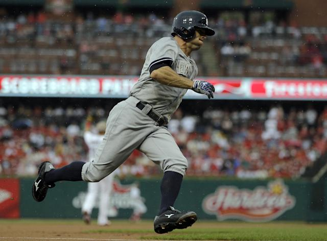 New York Yankees' Brett Gardner runs home to score on a single by Jacoby Ellsbury during the first inning of a baseball game against the St. Louis Cardinals Monday, May 26, 2014, in St. Louis. (AP Photo/Jeff Roberson)