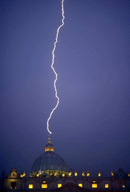 Lightning strikes St Peter's dome at the Vatican on February 11, 2013, the day the pope announed his was resigning