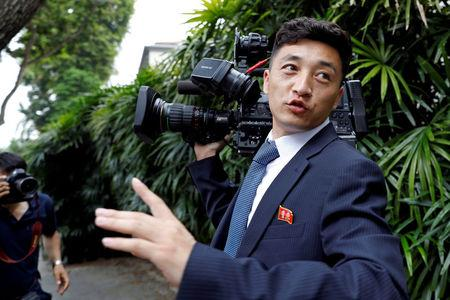 FILE PHOTO: A North Korean cameraman reacts as he is chased by media outside St Regis hotel, ahead of the summit between the North Korean leader Kim Jong Un and U.S. President Donald Trump, in Singapore June 10, 2018.  REUTERS/Tyrone Siu/File Photo