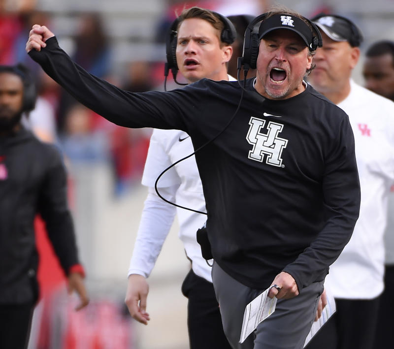 Houston head coach Dana Holgorsen, right, reacts to an official's call during the first half of an NCAA college football game against Memphis, Saturday, Nov. 16, 2019, in Houston. (AP Photo/Eric Christian Smith)