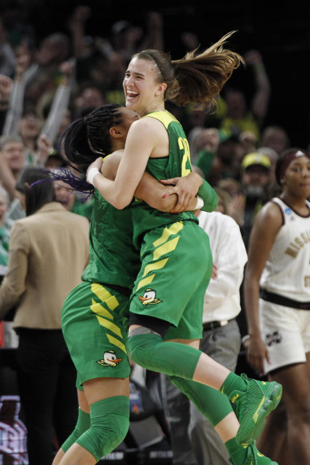 FILE - In this March 31, 2019, file photo, Oregon forward Satou Sabally, left, and Oregon guard Sabrina Ionescu, right, celebrate a regional final victory over Mississippi State in the NCAA women's college basketball tournament in Portland, Ore. Ionescu was a unanimous choice Monday, March 23, 2020, as The Associated Press women's basketball player of the year. (AP Photo/Steve Dipaola, File)