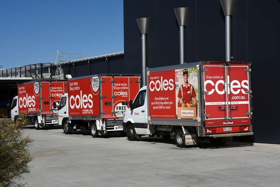 Coles delivery trucks lined up outside the supermarket