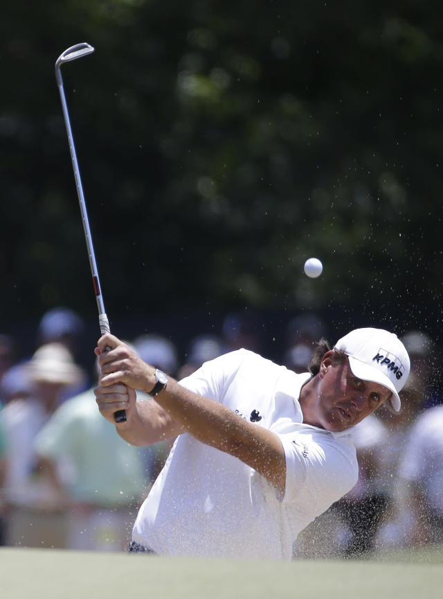 Phil Mickelson hits out of the bunker on the fifth hole during the third cround of the U.S. Open golf tournament in Pinehurst, N.C., Saturday, June 14, 2014. (AP Photo/David Goldman)