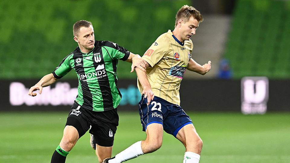 Pictured here, Western United and Newcastle Jets players compete for the ball in the A-League.
