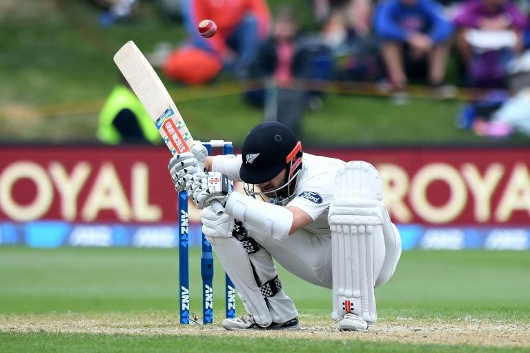 New Zealand's captain Kane Williamson ducks a bouncer on day three of their first Test match against South Africa, at the University Oval in Dunedin, on March 10, 2017