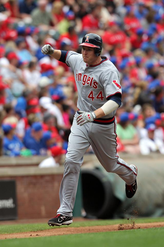 ARLINGTON, TX - MAY 12: Mark Trumbo #44 of the Los Angeles Angels of Anaheim rounds third base and celebrates his 2-run homer against the Texas Rangers in the 4th innning on May 12, 2012 in Arlington, Texas. (Photo by Layne Murdoch/Getty Images)