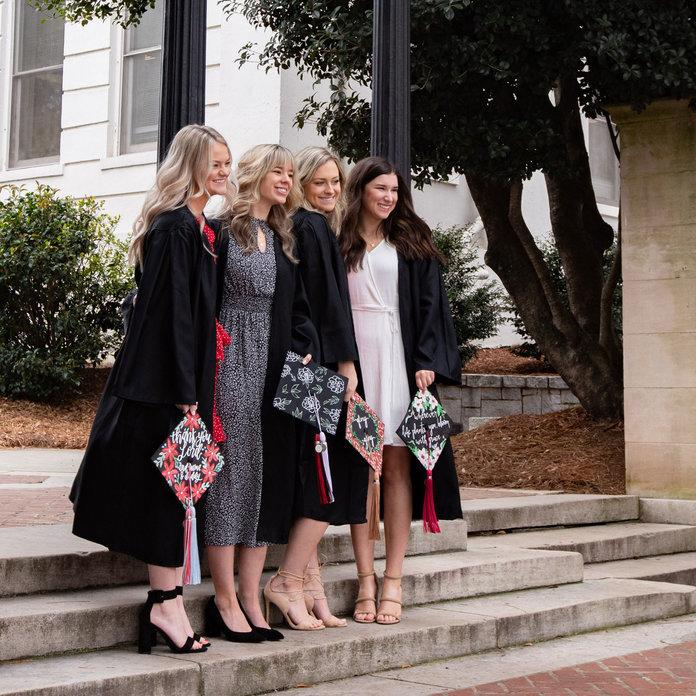 University of Georgia seniors (left to right) Aly Jones, Celeste Norton, Claudia Head, and Alexandria Hunt staged a graduation photo session on Monday, March 16th, UGA's first day of a two-week suspension following spring break. The group was happy to have an empty campus for photos but collectively dismayed at the uncertainty of what graduation and their final days as UGA undergrads will look like. | Caroline Head