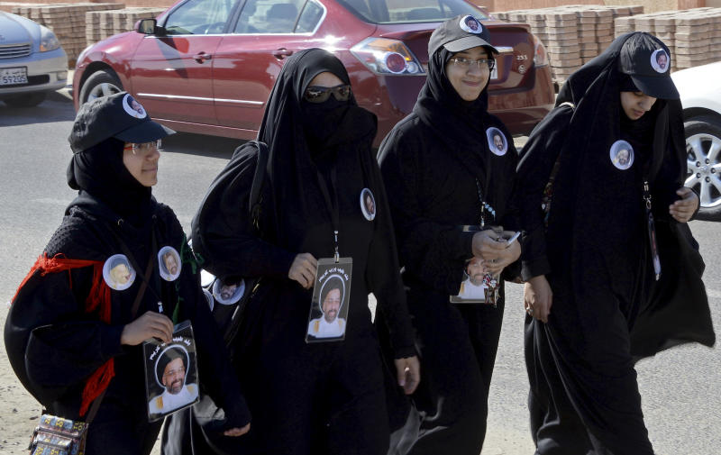 Kuwaiti supporters of one of the parliamentary election's candidates walks by a polling station in Salwa during election day in Kuwait on Saturday, Dec. 1, 2012. The general election to appoint a new Parliament is the fifth since mid-2006, and the second this year.(AP Photo/Gustavo Ferrari)