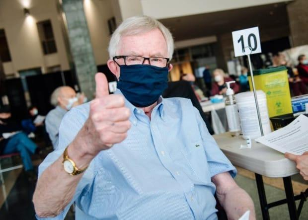 Former prime minister Joe Clark gets his COVID-19 vaccine shot at City Hall in Ottawa on March 23. (@catherinejclark - image credit)