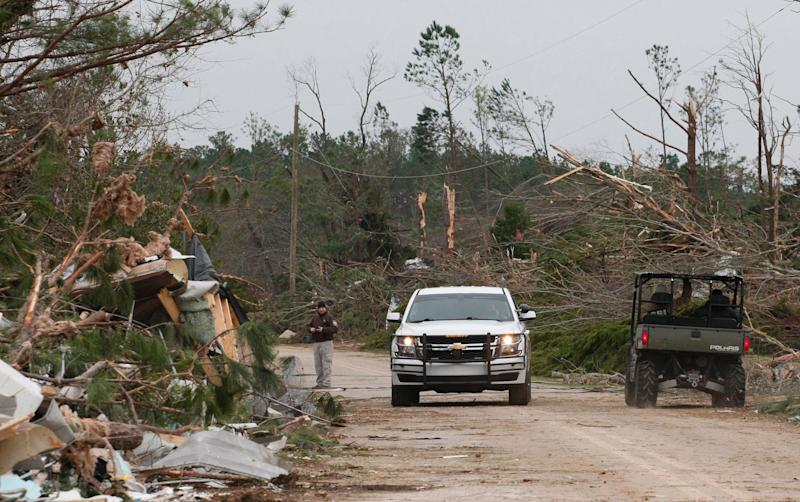 Damage from a tornado which killed at least 23 people is seen as Lee county deputies secure the scene in Beauregard, Alabama on March 4, 2019. (Photo: Tami Chappell/AFP/Getty Images)