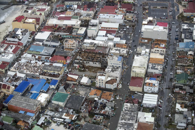 <p>Storm damage in the aftermath of Hurricane Irma, in St. Maarten. Irma cut a path of devastation across the northern Caribbean, leaving thousands homeless after destroying buildings and uprooting trees. Significant damage was reported on the island that is split between French and Dutch control. (Photo: Gerben Van Es/Dutch Defense Ministry via AP) </p>