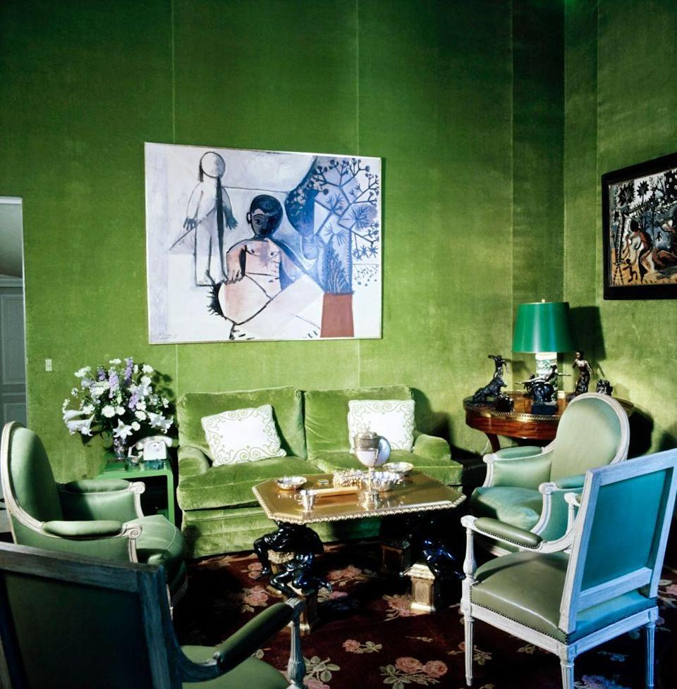 <p>A large Picasso from 1956 titled <em>La Famille</em> takes center stage in the salon of Sao and Pierre Schlumberger's Paris residence, featuring walls covered in a vibrant green linen velvet.</p>