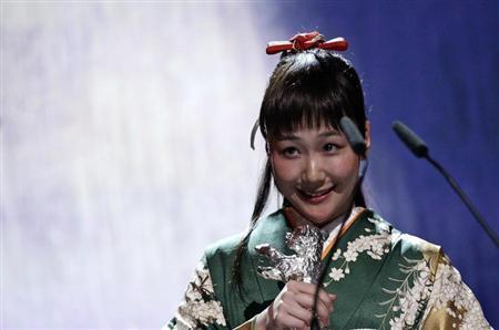 Japanese actress Haru Kuroki reacts as she won the Silver Bear award for best actress during the awards ceremony of the 64th Berlinale International Film Festival in Berlin February 15, 2014. REUTERS/Tobias Schwarz