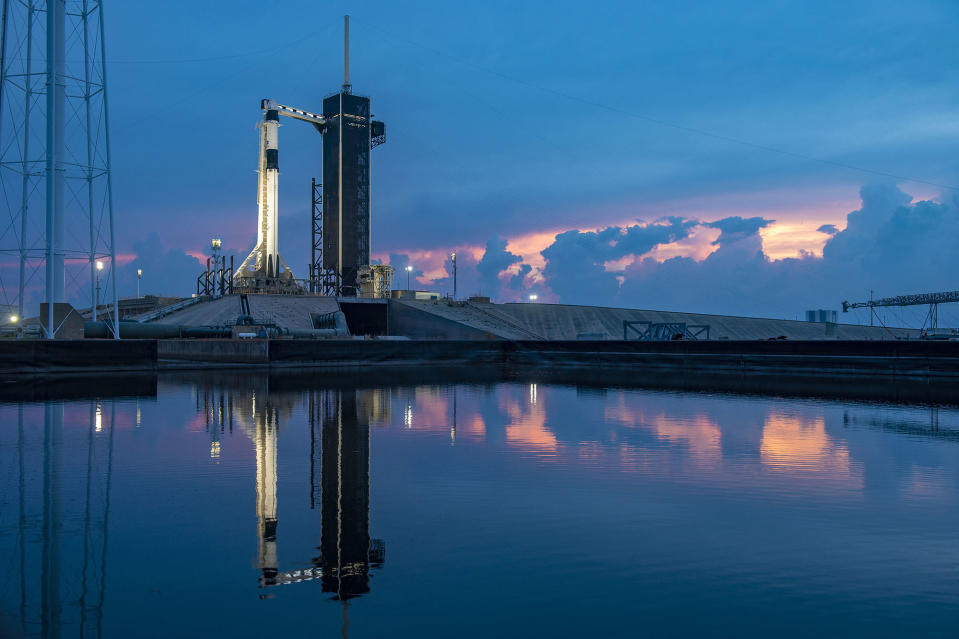 The sun sets behind a SpaceX Falcon 9 rocket on Launch Complex 39A at the Kennedy Space Center in Florida for the last time before the rocket's planned launch of two NASA astronauts to the International Space Station. The Falcon 9 rocket, topped with SpaceX's Crew Dragon spacecraft, is set to launch the Demo-2 mission from this historic launch pad today at 4:33 p.m. EDT (2033 GMT), weather permitting. On board will be Bob Behnken and Doug Hurley, who will become the first NASA astronauts to travel to the International Space Station in a commercial spacecraft. SpaceX founder Elon Musk tweeted this photo on Tuesday night (May 26).