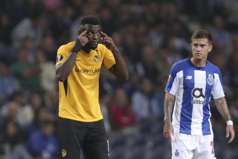 Young Boys' Jean-Pierre Nsame, left, gestures after scoring his side's first goal from the penalty spot during the Europa League group G soccer match between FC Porto and Young Boys at the Dragao stadium in Porto, Portugal, Thursday, Sept. 19, 2019. (AP Photo/Luis Vieira)