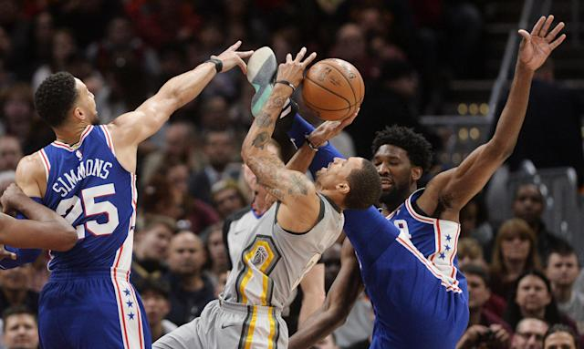 Mar 1, 2018; Cleveland, OH, USA; Cleveland Cavaliers guard George Hill (3) is fouled by Philadelphia 76ers center Joel Embiid (21) as guard Ben Simmons (25) defends during the first half at Quicken Loans Arena. Mandatory Credit: Ken Blaze-USA TODAY Sports TPX IMAGES OF THE DAY