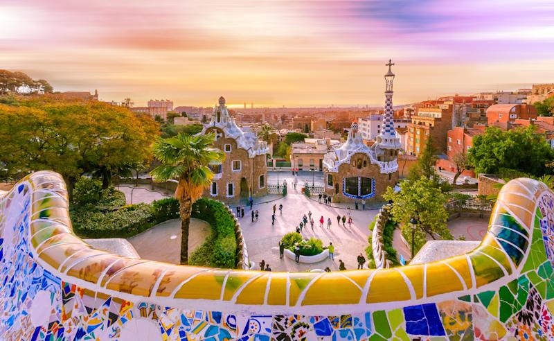 View of the city from Park Guell in Barcelona, Spain with moving clouds. Photo: Getty